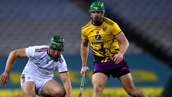 Fintan Burke of Galway in action against Matthew O'Hanlon of Wexford