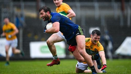 Aidan O'Shea is tackled by Oisin Mac Cafraigh