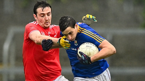 Darren Gallagher rounds Tommy Dunne in Longford's narrow win over Louth