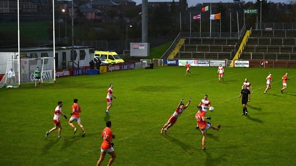 Jarly Óg Burns lobs over a point for Armagh