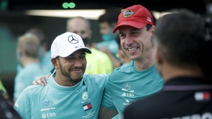 Hamilton (L) poses with Toto Wolff as they celebrate their record seventh consecutive constructor's championship