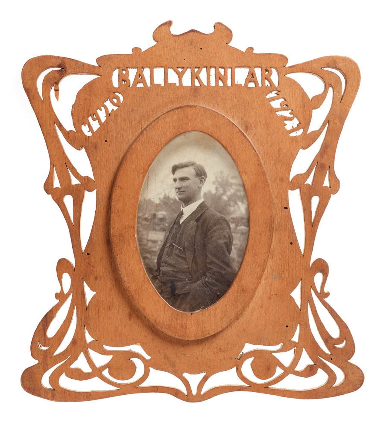Image - Photograph of Mr. Joseph McGrath in carved frame. Image courtesy of the National Museum of Ireland HE:EW.598