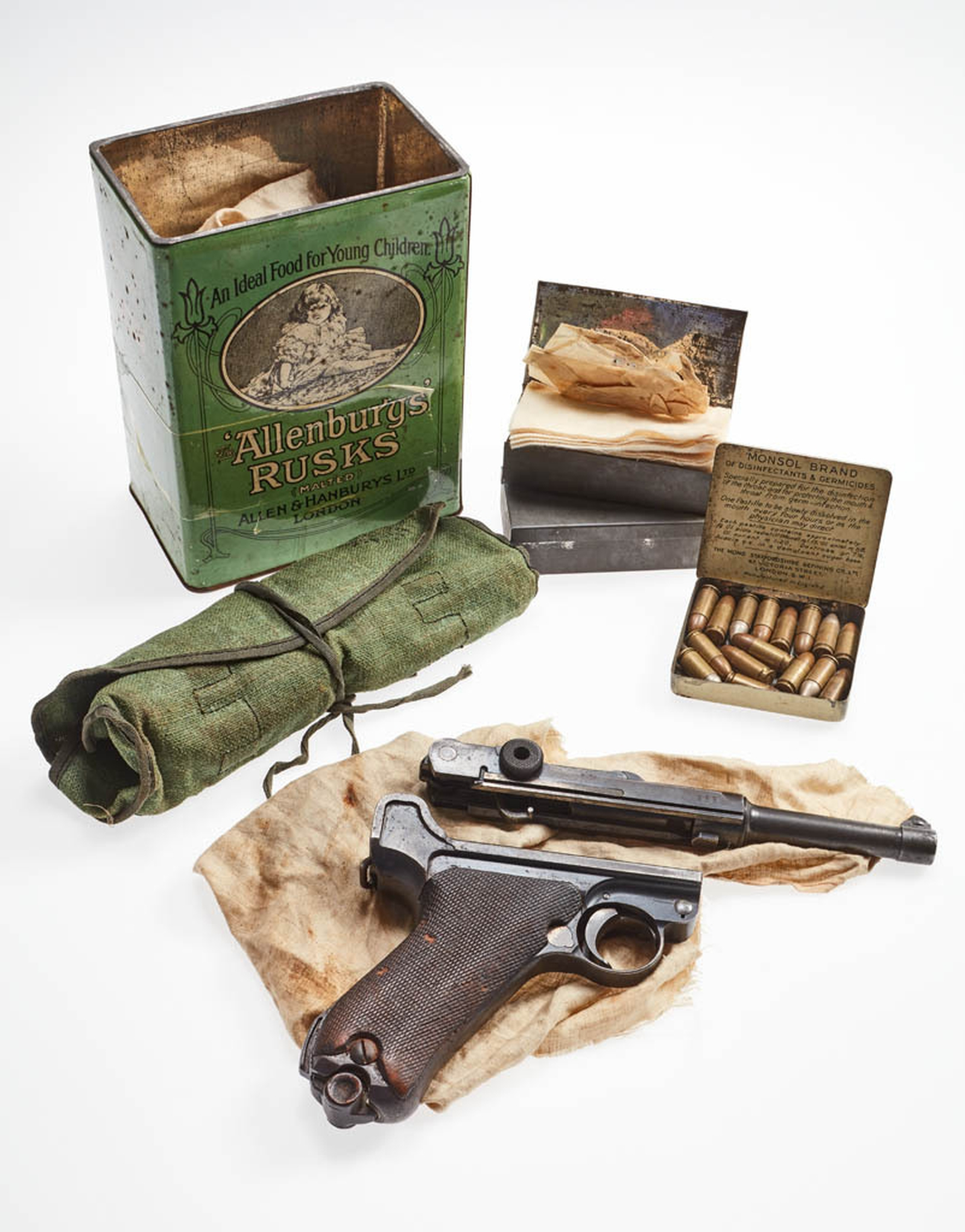 Image - Luger pistol, ammunition and cleaning kit found stashed in a Allensbury's Rusk tin, c. 1922. Image courtesy of the National Museum of Ireland HA:2012.25