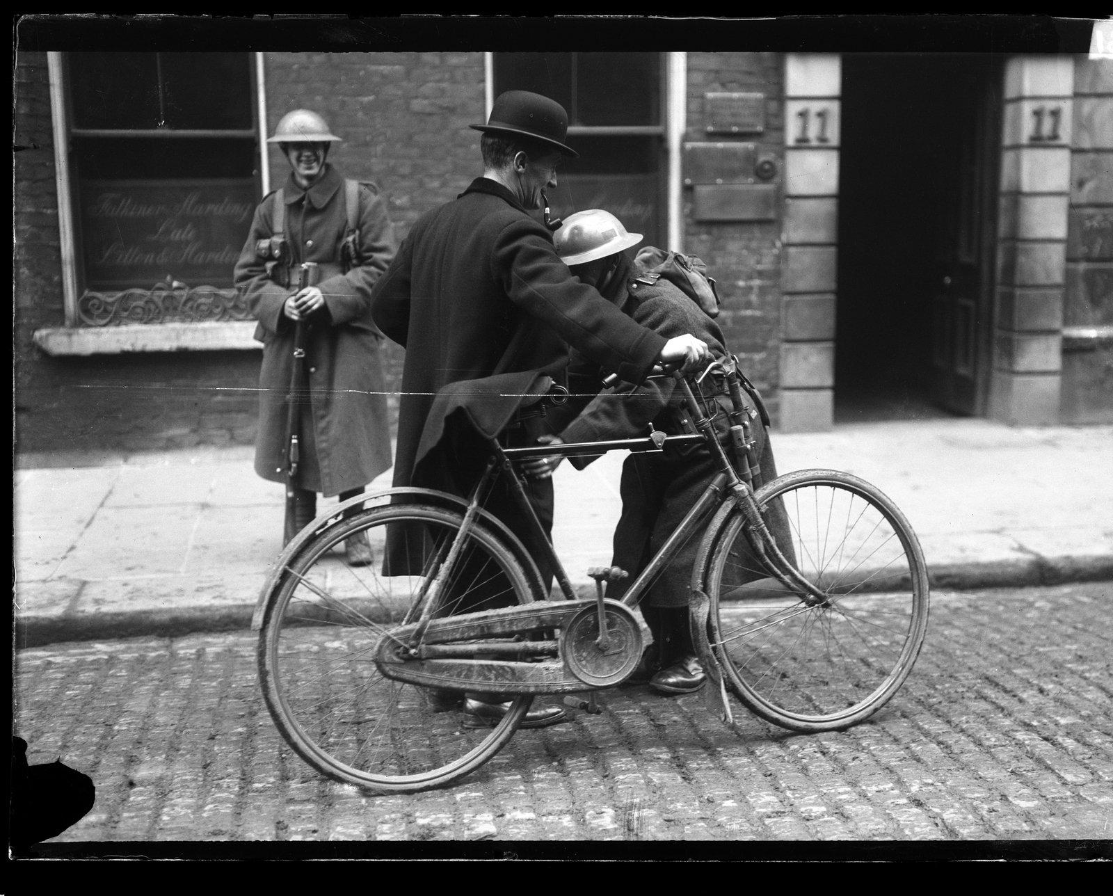 Image - A soldier searches a civil in Drumcondra, Dublin. Image: RTE Photographic Archive