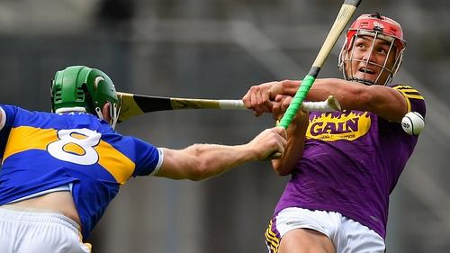 Noel McGrath blocks Lee Chin's shot during last year's All-Ireland semi-final
