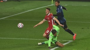 Diogo Jota lifts the ball past Atlanta keeper Marco Sportiello for his and Liverpool's first goal