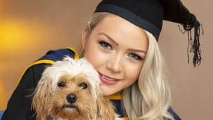 Grace Nolan from Tullow, Co Carlow pictured at home with her dog Teddie before her online conferring ceremony