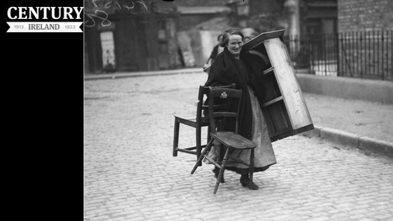A woman fleeing her home with some of her furniture after the sack of Balbriggan Photo: RTÉ Archives