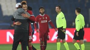 Jurgen Klopp hugs Rhys Williams following Liverpool's win over Atalanta
