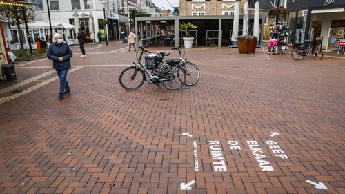 Call to keep a distance due to the coronavirus in the centre of Almelo, the Netherlands, today