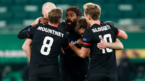 Dundalk players celebrate David McMillan's penalty kick that brough the Lilywhites level with Rapid Vienna in the 82nd minute