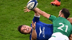 Antoine Dupont (L) is tackled by Ireland's scrum-half Jamison Gibson-Park (R)