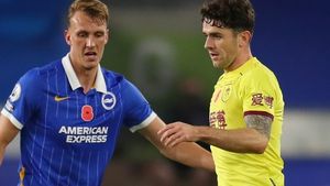 Robbie Brady (right) started for Burnley while Aaron Connolly was a late substitute for Brighton