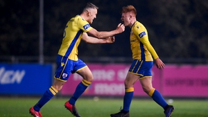 Longford Town's Aodh Dervin, right, celebrates after scoring his side's second goal with team-mate Mick McDonnell