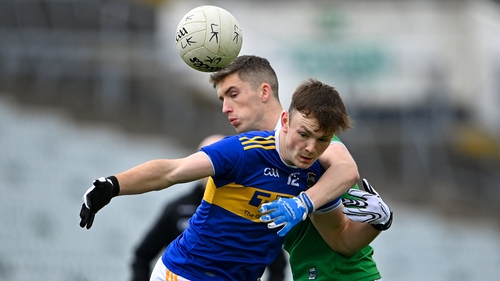 Emmet Moloney of Tipperary in action against Seán McSweeney of Limerick