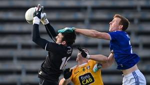 Oisin Kerr, left, and James McAuley of Antrim in action against Jason McLoughlin of Cavan