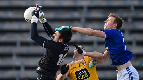 Oisin Kerr, left, and James McAuley of Antrim in action against Jason McLoughlin of Cavan