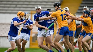 Ryan Mullaney of Laois is tackled by Cathal Malone of Clare