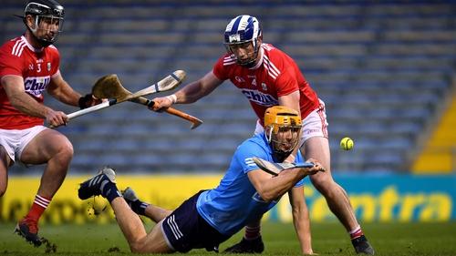 Éamon Dillon of Dublin comes under pressure from Seán O'Donoghue (r) and Colm Spillane