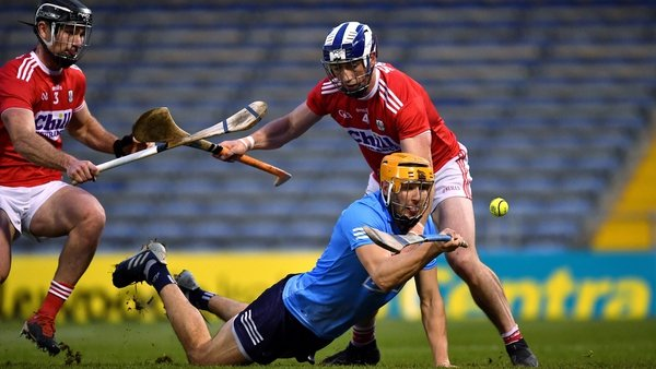 Éamon Dillon of Dublin comes under pressure from Seán O'Donoghue (r) and Colm Spillane