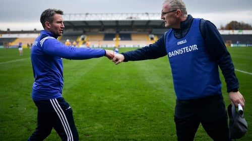 Laois manager Eddie Brennan, (L) fist bumps Clare manager Brian Lohan after the game