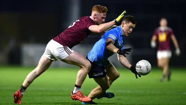 Con O'Callaghan being pursued by Ronan Wallace