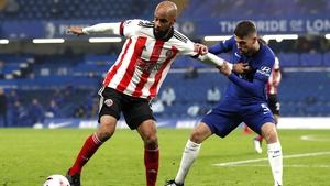 David McGoldrick and Jorginho battle for possession