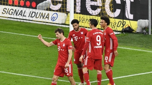 Bayern's Leroy Sane, right, celebrates with teammates after scoring his side's third goal