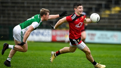 Daniel McGuinness of Down in action against Cain McManus of Fermanagh
