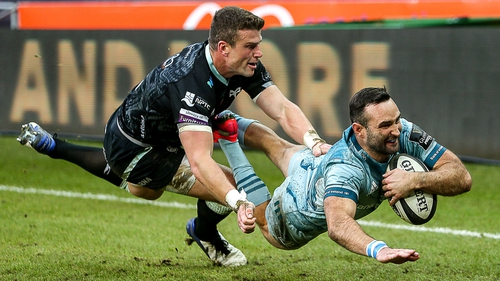 Dave Kearney dives to score Leinster's second try despite the attentions of Scott Williams of Ospreys