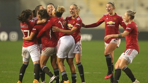 Toone of Manchester United celebrates with teammates