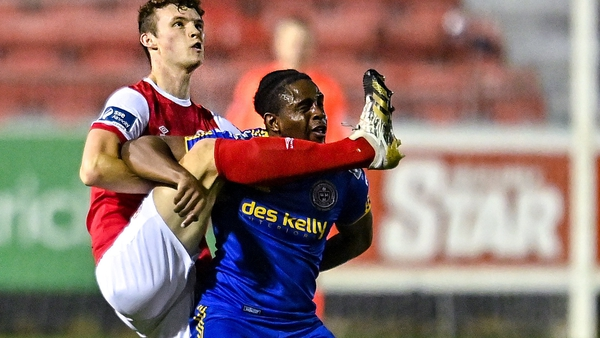 Luke McNally of St Patrick's Athletic (l) in action against Andre Wright of Bohemians