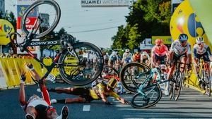 Dylan Groenewegen (C) caused the horror crash when he veered off his racing line