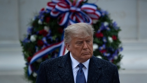 Donald Trump leaves after placing a wreath at the Tomb of the Unknown Soldier on Veterans Day at Arlington
