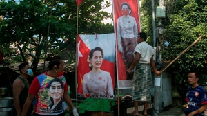 Supporters of the National League for Democracy party celebrate in Yangon
