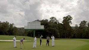 Players practice at a cloudy Augusta on Wednesday