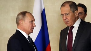 Sergei Lavrov (R) pictured with Russian President Vladimir Putin