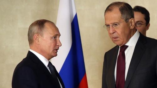 Sergei Lavrov (R) pictured with Russian President Vladimir Putin