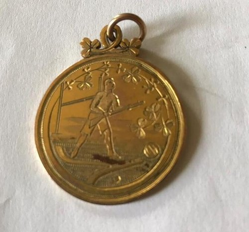 The medal, similar to the one Gus received for the commemorative match he played in 1921