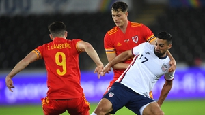 Sebastian Lletget of USA is tackled by Wales' Tom Lawrence