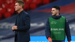 Stephen Kenny watches on as former Ireland player and current England sub Declan Rice warms up