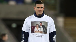 Northern Ireland's Kyle Lafferty wears a t-shirt in memory of his sister Sonia during the warm-up ahead of Thursday's Euro 2020 play-off against Slovakia