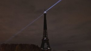 The lights of the Eiffel tower are switched off to pay tribute to the victims
