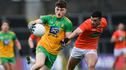 Niall O'Donnell of Donegal gets away from Conor O'Neill of Armagh