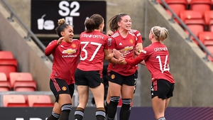 Kirsty Hanson celebrates with teammates after her equaliser for United
