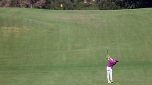 Rory McIlroy attacks the par-five eighth hole in two during his third round.