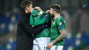 McGovern (L) and Stuart Dallas console Kyle Lafferty after the Slovakia defeat.
