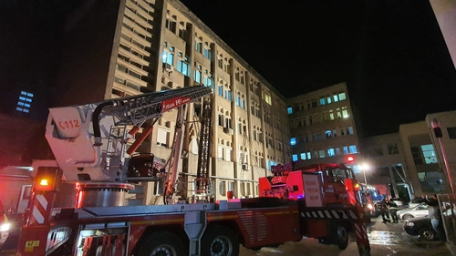 Emergency services work at the scene of a hospital fire where the intensive care unit was burned in Piatra Neamt