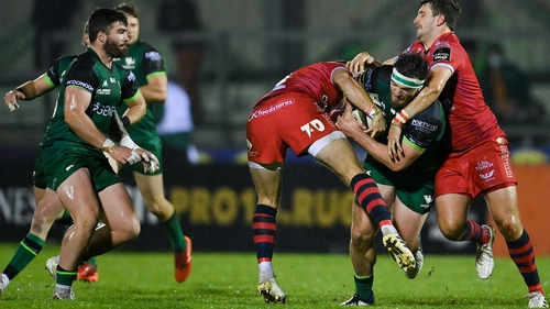Tom Daly of Connacht is tackled by Scarlets' Steff Hughes, left, and Dan Jones at the Sportsground.