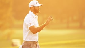 Dustin Johnson walks off the 18th green at Augusta after his third round.